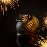 Mask welder on the background of sparks from welding process Stock Image
