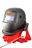 Mask of the welder, electrode and gloves Stock Photography