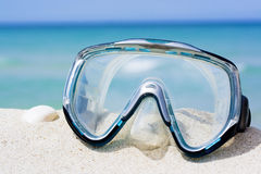 Mask on white sand beach Royalty Free Stock Photos