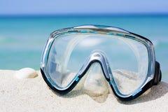 Mask on white sand beach Royalty Free Stock Photos