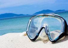 Mask on white sand beach Royalty Free Stock Photo