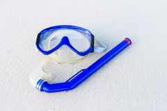 Mask on white sand beach Royalty Free Stock Images