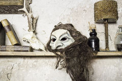 Mask of witchcraft. Scary mask on old house, gothic decoration Stock Photos