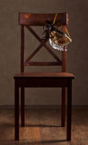 Mask on  wooden chair Royalty Free Stock Image