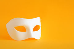 Mask On Yellow Stock Image