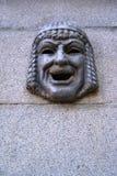 Maskaron - театральная маска на стене гранита St Petersburgi Стоковая Фотография