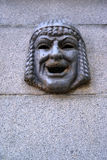 Maskaron - a theatrical mask on a granite wall. St. Petersburgi Stock Photography