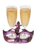 Maske und Champagner Stockfotos