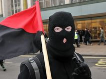 Masked Anarchist Protester in London. A masked anarchist protester attends a large anti-cuts rally on March 26, 2011 in London, UK Royalty Free Stock Photos