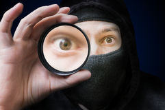 Masked anonymous hacker or spy is spying and doing espionage Royalty Free Stock Photos