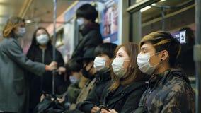 Asian people subway. Asia Metro. Mask China. Corona virus. Chinese coronavirus.