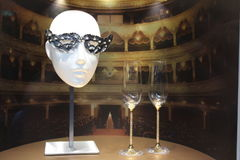 Masked ball crystal mask. Swarovski mask for a masked balled next to two champagne glasses Royalty Free Stock Photos