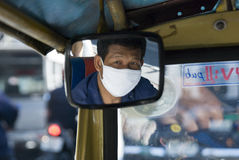 Masked Bangkok tuk-tuk driver Royalty Free Stock Photography