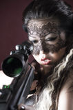 Masked beautiful asian woman with rifle Royalty Free Stock Photos