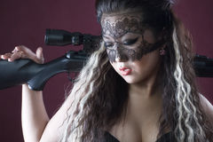 Masked beautiful asian woman with rifle Stock Image