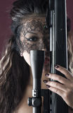 Masked beautiful asian woman with rifle Stock Photos
