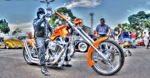 Masked biker on custom motorbike Royalty Free Stock Images