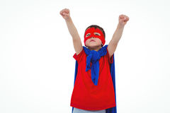 Masked boy pretending to be superhero. Masked boy raising fists pretending to be superhero on white screen Stock Image