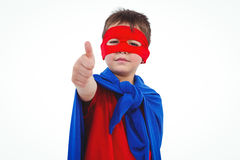 Masked boy pretending to be superhero. Masked boy showing thumb up pretending to be superhero on white screen Stock Image