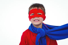 Masked boy pretending to be superhero. On white screen Stock Photos