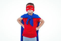 Masked boy pretending to be superhero. On white screen Stock Photo