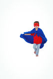 Masked boy running pretending to be superhero. On white screen Stock Photography