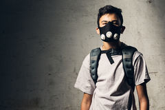 Masked boy. Masked young boy in a gray T-shirt Stock Photography