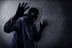 Masked burglar caught by police royalty free stock photography