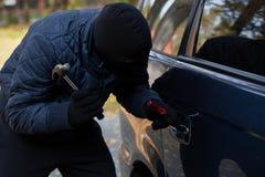 Masked burglar with hammer Royalty Free Stock Photos