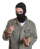 Masked burglar with jewelry. On an isolated white background for cut out stock photos