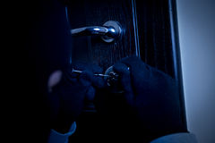 Masked burglar Stock Photo