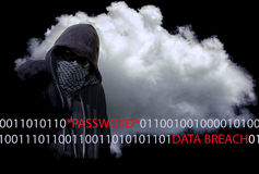 Masked Computer Hacker Thief Concept. Hooded and masked computer hacker thief with a cloud computer based background and binary code. Unknown technology threat Stock Images