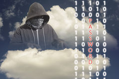 Masked Computer Hacker Thief Concept. Hooded and masked computer hacker thief with a cloud computer based binary code background. Unknown technology threat to Royalty Free Stock Photos