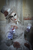 Masked costumed musician woman Stock Images