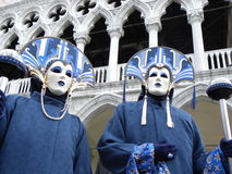 Masked couple in blue costumes at carnival Stock Photo