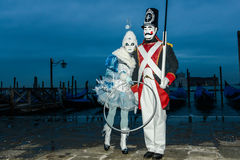 Masked couple at dawn Royalty Free Stock Photo