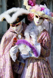Masked couple in elegant silk dress Royalty Free Stock Photo