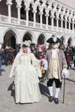 Masked couple walking in Venice Royalty Free Stock Photography