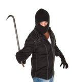 Masked Criminal. Menacing robber weilding a big crowbar on white background Stock Images
