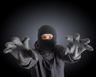 Masked criminal Stock Image