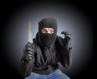 Masked criminal Royalty Free Stock Image