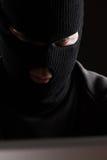 Masked Criminal Accessing Computer Data Stock Photos
