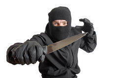 Masked criminal holding a knife Royalty Free Stock Image