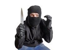Masked criminal holding a knife Royalty Free Stock Image
