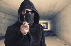 Masked criminal holding a knife Royalty Free Stock Photography