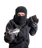 Masked criminal holding a stolen leather purse Stock Images
