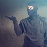 Masked criminal Royalty Free Stock Image