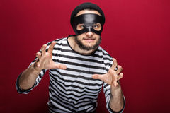 Masked criminal ready to fight Stock Photos
