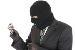Masked criminal stealing credit cards Royalty Free Stock Image