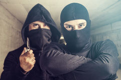 Masked criminals. Royalty Free Stock Photography